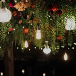 hanging flowers with decanter lights and Edison bulbs at the Currant Shed